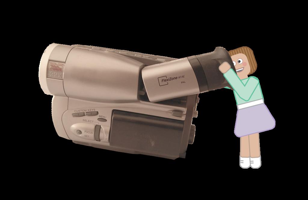 Câmara de filmar amadora com a mascote animada da Tell Now a espreitar para o visor, misturando-se fotografia com animação gráfica.